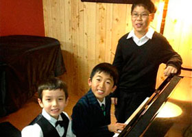 After their Recital JUNE 2013, young pianists Victor ZHOU (standing), Sean Weatherley (front) and Dan Zhang.