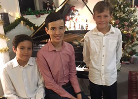 L. to R. Petelo, Atonio and Filipo Devine following their successful performances Christmas Concert 2018
