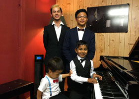 Celebrating after a recital at the Workshop. Seated Vincent Kristyono, Midhvan Krishvi, R.to L. at back Zach Torrevillas, Brandon King