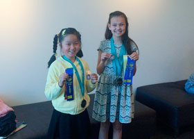 PENRISTH EISTEDDFOD PRELIMINARY  WINNERS: R. to L. ZARA EADE Champion and Sienna Li Runner up
