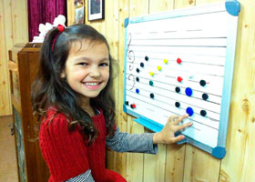 7 yr. old Zara Eade enjoying learning to read and write music.